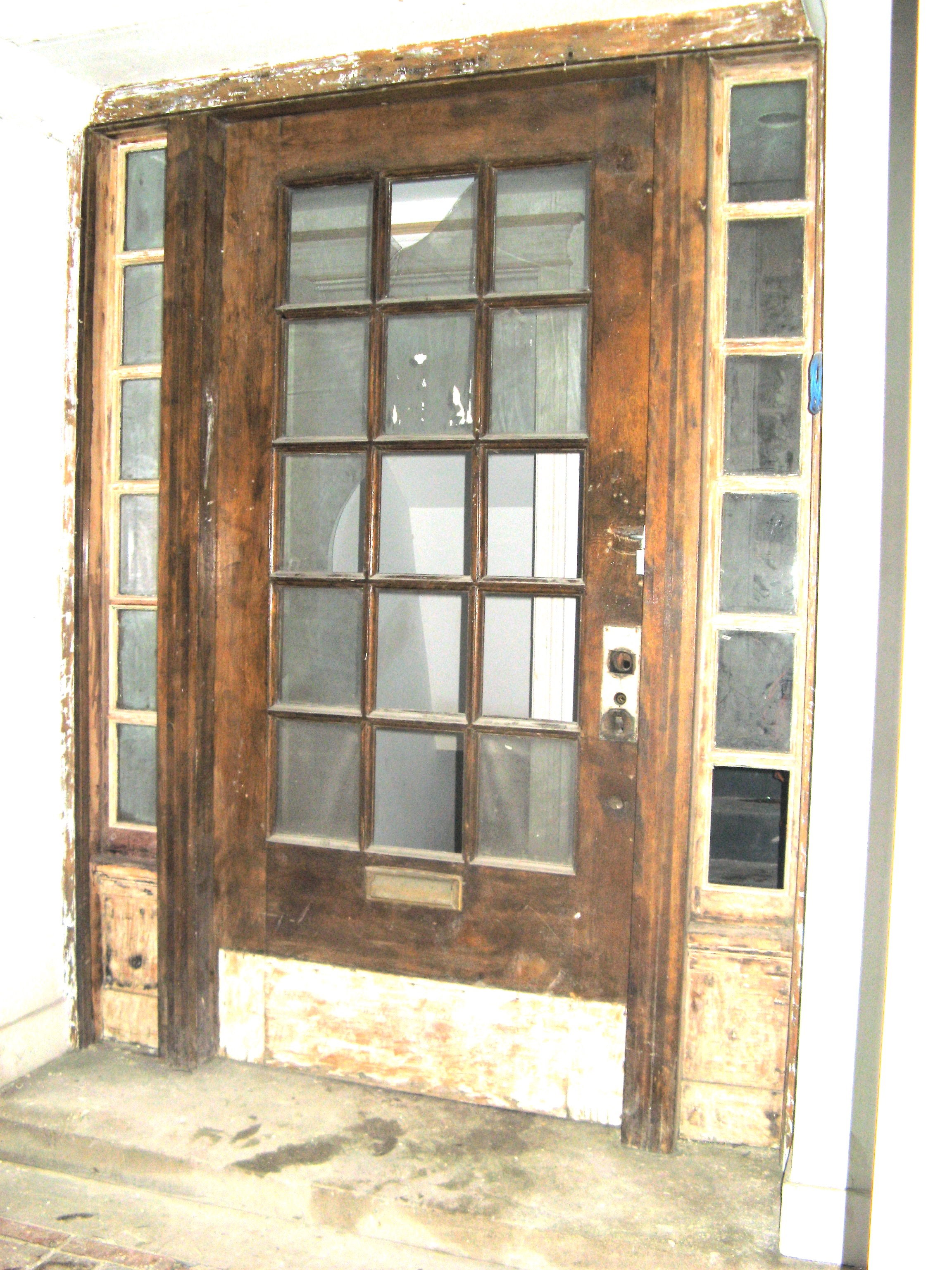 This is the entryway to a house with a historic facade easement which required the architect to either restore it or replace it with an exact reproduction. & Logan Square Doors - Oak Brothers